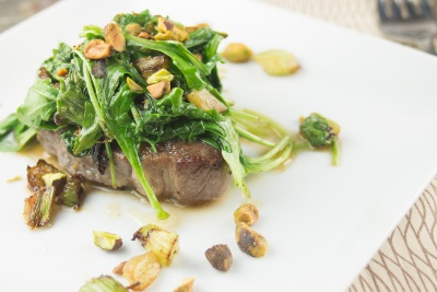 Lamb Chops with Wilted Arugula and Pistachios